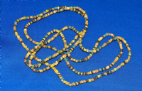 A very long (circa 48 inch) restrung necklace of Ancient Egyptian multicoloured Faience beads. SOLD